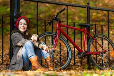 Smiling girl with a bike.